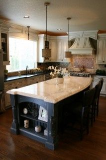 Cabinets and black island.