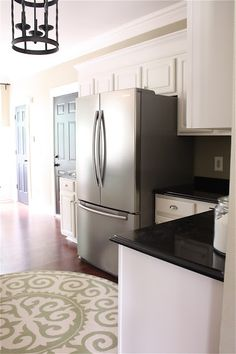 The Yellow Cape Cod: builder cabinets-Adding molding for height