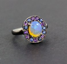 Excited to share the latest addition to my #etsy shop: Australian jelly opal with amethyst and blue sapphire halo in oxidized black gold ring size 6 http://etsy.me/2txP8Bv #jewelry #ring #blue #black #opalring #opalengagementring #opaljewelry #amethystring #amethystjew