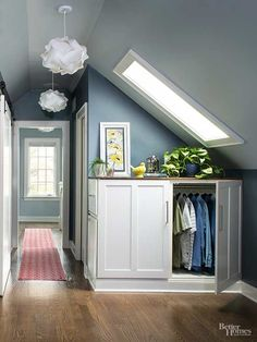 In the hall outside the closet, a base cabinet tucks under a skylight. Designed to serve as a second spot for hanging clothes, there's more than enough storage in this master suite./
