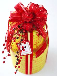 Nesting Boxes ~~ Turn a set of gift boxes into a special stacked present by wrapping them together with coordinating ribbon. Top with a grand bow and a sprig of winter berries.