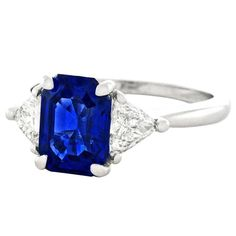Circa 1960-70s, this extraordinary Cartier three-stone ring is set with a stunning 1.97 carat no-heat Burma sapphire exhibiting all the best characteristics of natural sapphires - a sublime cornflower blue color, even saturation, superb clarity, and no heat or other enhancements. The side stones are triangular brilliant cuts, each .27 carats for a total weight of .54 carats (F color, VS clarity).