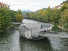 A man-made floating island in the middle of the Mur river in Graz, Austria.  On the outside there is an amphiteatre, and on the inside there's a cafe.