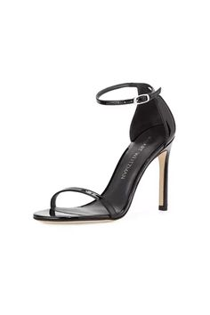 "Stuart Weitzman Nudistsong Sandal Black Patent Versatility reigns with these minimalist must-own sandals. Encapsulating the sizzle of the now-iconic 4 ½-inch NUDIST stiletto in a 3 ¾-inch heel, the nudist song pairs perfectly with pencil skirts and tuxedo trousers and stands to be the season's show stopping staple. Adjustable buckle ankle strap with hidden elastic for comfort.     Approx. heel height 3.75""   Nudist Song Sandal Black by Stuart Weitzman. Shoes - Pumps & Heels - Open Toe Shoes…"