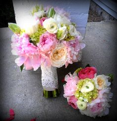 This elegant bouquet is made with Pink Peonies, Cream Garden Roses, Parrot Tulips, Mini Green Hydrangeas, White Ranunculus and is wrapped in a Champagne Satin wrap with a Lacey overlay. The bridesmaid bouquet is a smaller version of the brides and has no Parrot tulips included www.flowersfromus.net