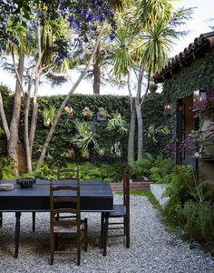 Rustic Vintage Garden: Outdoor garden surrounding dining table..