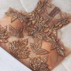 Oh my, what a stunning design! This is actually a crop top from a portuguese designer, but I'm sure we can steal some inspiration for saree blouses from this!