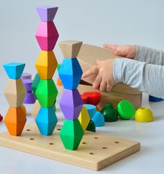 "Minitremu: Modular geometric wooden block toys based on sculptures by Constantin Brancusi, ""Endless Column"" and ""Table of Silence""."