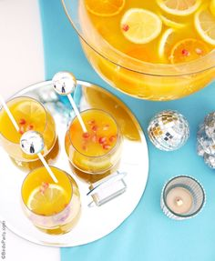 Sparkling Citrus Holiday Sangria Recipe - a perfect big-batch Champagne and fruit cocktail to serve a crowd at your Christmas and end-of-year parties! | BirdsParty.com