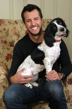 Men and dogs, Luke Bryan knows how it is....don't get me wrong the puppy is cute but Luke Bryan is way cuter lol!