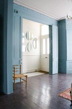 white entrance hall , pale blue room