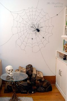 Spider web and spider.... could make extra webs around the house..... how about some baby spiders ?? $1 for the yarn at the Dollar Store, $1 for the two way tape. If you need to go out and buy the spiders, that'll set you back another dollar instructions on her site
