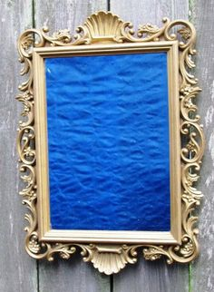 Hey, I found this really awesome Etsy listing at http://www.etsy.com/listing/99163170/1988-vintage-ornate-mirror-wall-decor