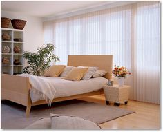 Hunter Douglas Luminette® Privacy Sheers are showcased in the urban-style bedroom shown here and provide an elegant, soft contrast to the strong lines of the bedroom furnishings.