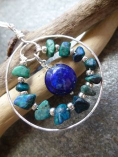 This beautiful pendant combines two of my favourite gemstones with a hand formed circle of 925 sterling silver wire. Stunning blue green chrysocolla chips are interspersed with high quality Japanese silver galvanised miyuki seed beads and wired into the centre of a hammered sterling