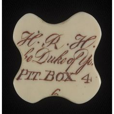Ivory ticket for the Duke of York's box at the King's Theatre in London's Haymarket for the 1804/5 opera season. It shows that he had Pit Box 4 which seated 6 people, so would have contained 6 arm-chairs. Six passes like this would have been issued, the details engraved, and the recesses filled with dark red ink. Originally this ivory would have been round or oblong but it has been carved into a quatrefoil shape. The Duke of York in 1804 was Prince Frederick 2nd son of King George III