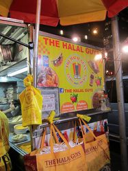 The halal guys -the best cart is on 53rd and 6th! Have eaten at many. This is really the beat.