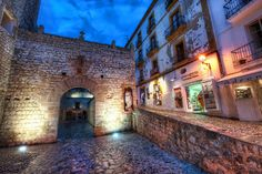 The old part of Ibiza is has a medieval layout where the inner city is ringed by a city curtain wall. Once inside, all the streets are narrow and twisty and lined with different kinds of stone. This looks back at the main entrance to the area. - Ibiza, Spain - Photo from #treyratcliff Trey Ratcliff at http://www.StuckInCustoms.com