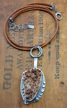 Joy Kruse of Wild Prairie Silver Jewelry || This pendant is almost 4 inches long. The leather cord is thick and the end to the cording is handmade.   Link: https://www.etsy.com/listing/153032490/garnet-specimen-stone-sterling-silver