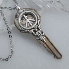 I've been seeking the key to peace all my life. From TrashAndTrinkets on Etsy.