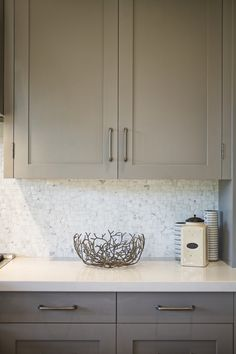 Urban farmhouse kitchen. Cabinets are Benjamin Moore Graystone paired with Pure White Caesarstone counter tops - KCS, inc.