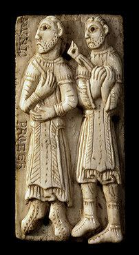 Medieval ivory plaque with two monks  holding carpenters instruments.  Reliquary shrine of San Millan de Cogolla,Spain 1060-1080