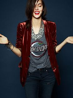 So me. Edgy casual (holiday/winter) fashion. Deep red velvet blazer, band tee, statement necklace, band tee slightly tucked with denim. It would be 10x better with high waisted bottoms though!! Red lips and stacked arm candy.