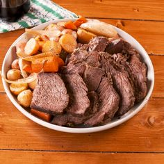 This slow cooker pot roast is insanely easy and impossibly flavorful. Here's how to make this perfect recipe for a cold winter night or when feeding a crowd. Pot Roast Recipes, Meat Recipes, Cooking Recipes, Chicken Recipes, Dinner Recipes, Healthy Recipes, Crock Pot Slow Cooker, Slow Cooker Recipes, Blade Roast Slow Cooker
