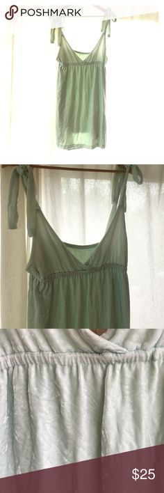 Velvet mint baby doll dress. Adjustable sleeves Luxurious and adorable. Perfect for all seasons. Adjustable straps make endless possibilities to wear it. Scored at a vintage shop, no tags so I don't know the brand. Fully lined so you can't see through. Nasty gal listed for exposure. Hard to capture the beautiful mint / sea foam color but it's gorgeous. Sizing is flexible because the tie straps. Nasty Gal Dresses