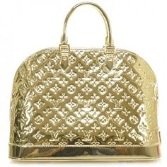 This is an authentic LOUIS VUITTON Miroir Mirror Alma MM Dore in Gold- LE- NEW. This stunning tote is crafted of shiny monogram embossed gold vinyl.