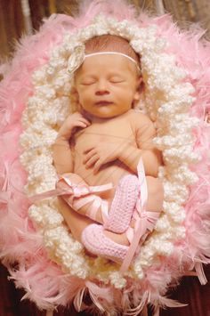 Newborn Photo Idea . . . Baby Ballerina in a fluffy, soft nest . . . This tiny dancer is gorgeous in custom crocheted ballet slippers and a simple headband.