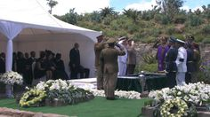 Mandela family members and South African President Jacob Zuma watch as former South African President Nelson Mandela's casket is lowered into his burial site following his funeral service in Qunu, South Africa, Sunday, Dec. 15, 2013. (AP Photo/SABC)