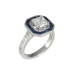 Lori Custom Made Asscher Cut Diamond With Custom Cut Sapphire Halo. Side View Showing Carré Shape Diamonds On The Band. #halo #sapphire #sapphirering #engagementring #asschercut #diamondandsapphire