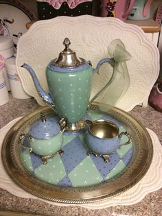 Its inventory reduction time...check out my shop for more sale items. This is a vintage silver plated tea set that I have custom painted. I never paint