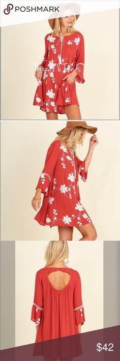 Crimson Bell Sleeve Tunic Dress Gorgeous crimson red tunic dress with white floral print.  featuring bell sleeves & embroider detail. Open back and front pockets Made of rayon size S, M, L striped Threads & Trends Dresses