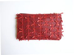 Alana - Lovely vintage inspired Red Clutch.  - Handmade item. - Allover mesh bows detail. - Brass zipper. - Fully lined. Dimensions: 10 wide x 6.5 tall  This item is Handmade with love, under a sunny California sky. All the materials are hand picked at the local shops and/or from fellow Etsy sellers.  ©2016 The Resort Collection. All Rights Reserved.  ------------------------------------------------------------------  ✉ DELIVERY ✉ Please refer to our FAQ down below for all the shipping info…
