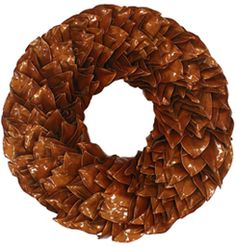 Pumpkin Lacquer Wreath - Perfect for Thanksgiving! Our beautiful handmade wreaths coated and sealed with a pumpkin color. This beautiful piece appears as if it was coated in glass and will last indefinitely. All colors will not fade or run. If used outdoors, it can be displayed in direct sunlight. Please keep out of direct moisture.