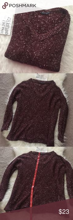 """Brandy Melville burgundy & white speckled sweater Brandy Melville knit sweater. """"One size"""" best for xs-m. Idk the style name, but I'm 5'0"""" xs/s and it's loose fitting, the sleeves are wide, and it covers my bum a little bit. V-neck. Dark burgundy color, with white.. speckles? I guess lol. Worn a few times. Flaws: Spotted some snags. :( But besides that, they're pretty minor like nothing like huge snags or holes/rips. I think they can be snipped off fine or tucked back in. Brandy Melville…"""