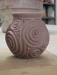 small vase, earthenware, thrown, carved, altered greenware .