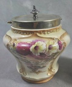 "English Biscuit Barrel -- Royal Devon, Stoke on Trent, transfer decorated, silver plated lid and handle rim embossed ""NS"", H 6 1/2"""