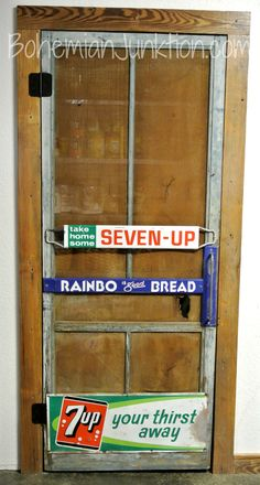 LOVE this old screen door with vintage signs now used as a pantry door!