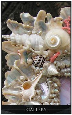 "sea shells...  bought a 12"" wreath at Habitat for $2 last week, going to cover it with shells & hang it on the front door for summer"