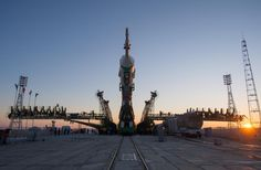 The Soyuz rocket is erected into position after being rolled out to the launch pad by train on Monday, December 17, 2012, at the Baikonur Cosmodrome in Kazakhstan.
