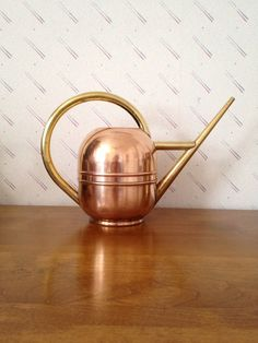 Vintage Art Deco Chase Copper and Brass Watering Can, 1930s, Centaur. $97.00, via Etsy.