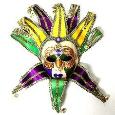 What an impact these full-face paper mache jester masks make that are hand painted and dimensionally shaped to the face.  The brocade collars and jester hats in Mardi Gras colors are shapeable.  Measuring 18 inches overall, the masks wearable as well as wall masks.  For more wholesale Mardi Gras masks, follow the link.  http://www.awnol.com/store/Masks/Mardi-Gras-Masks