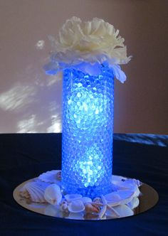 Sample Centerpiece - blue water beads, clear light inside, shells- created by Custom Events  Contact Custom Events for more centerpiece ideas!