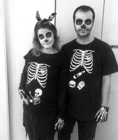 """Skeleton Family A fun twist on the traditional skeleton costume, this cute getup features a little skeleton """"inside"""" your belly — and food in your partner's stomach. Click through for more of the best Halloween costumes for pregnant women! Funny Pregnant Halloween Costumes, Pregnancy Costumes, Scary Costumes, Pregnancy Humor, Family Halloween Costumes, Scary Halloween, Halloween Ideas, Pregnancy Tips, Clever Costumes"""