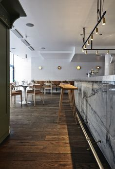 The Long John pendant light by Rubn at Restaurant Michel in Helsinki, photo by Mikko Ryhänen