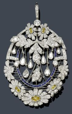 A BELLE EPOQUE SAPPHIRE AND DIAMOND PENDANT, ca. 1910.  Platinum.  Very fine pendant with flower motifs set with white and yellow diamonds and leaf motifs set with diamonds. Central frame set with small sapphire carrés and suspending six pear-shaped diamonds. #BelleÉpoque #Pendant #Edwardian