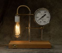 SOLD This is a combination of new and old. Alex Barrie machined the brass fittings and Scott Barrie polished aluminum tubes and created a wooden base. The working thermometer is old, but the lamp bulb is new. Brass Fittings, Lamp Bulb, Architectural Salvage, Mason Jar Lamp, Lamp Light, Repurposed, Objects, Base, Antiques
